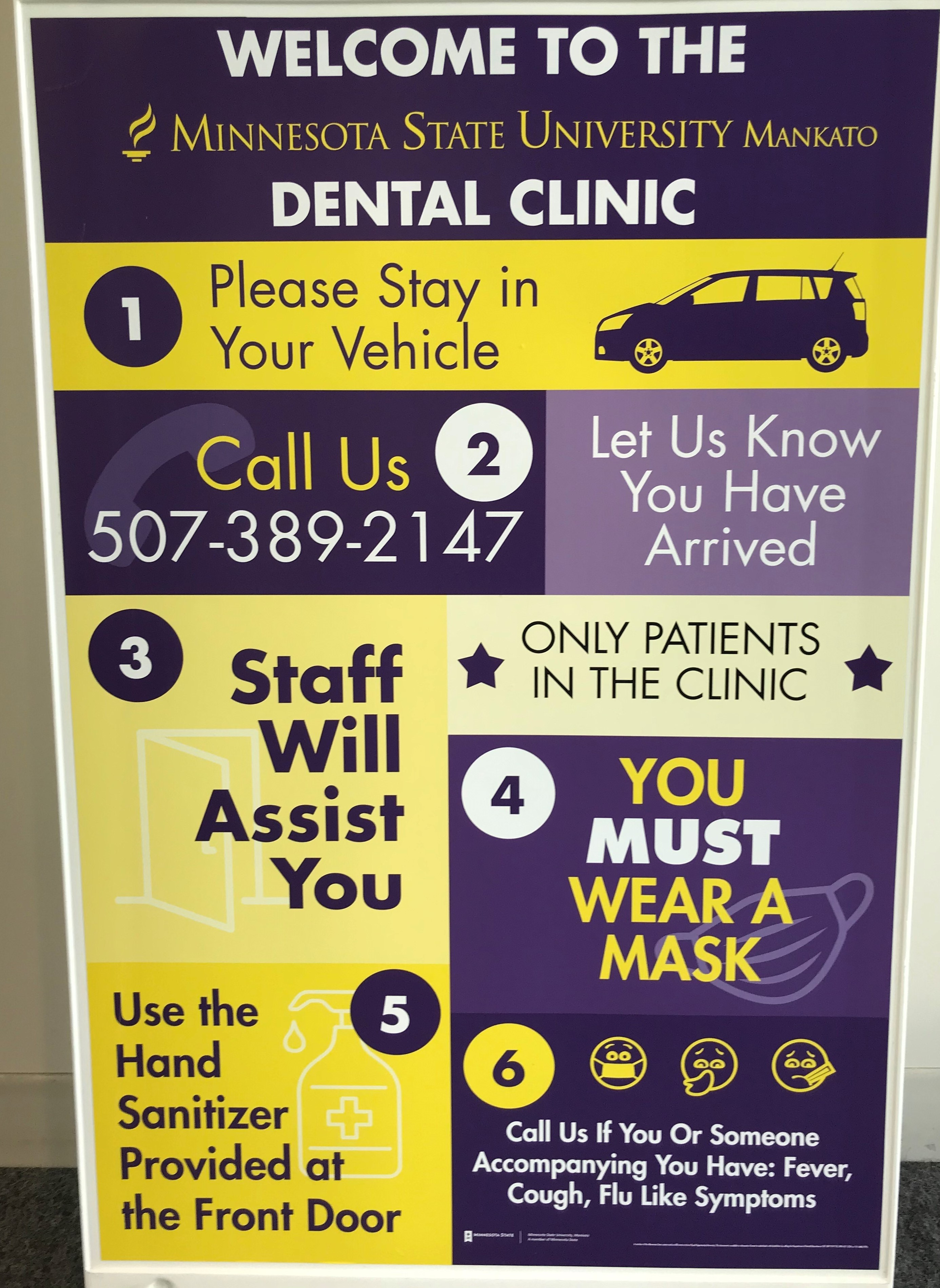 Sign with directions for arriving at dental clinic