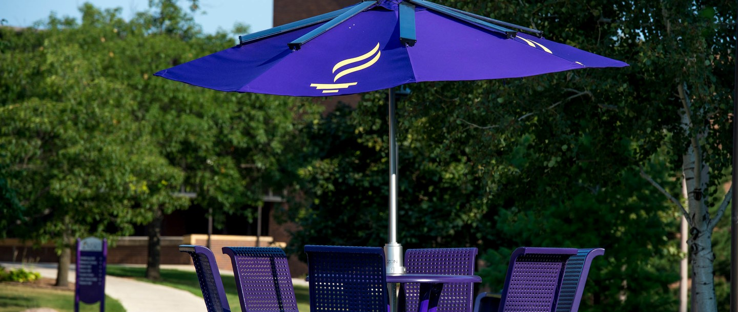 MSU logo umbrella with patio table and chairs