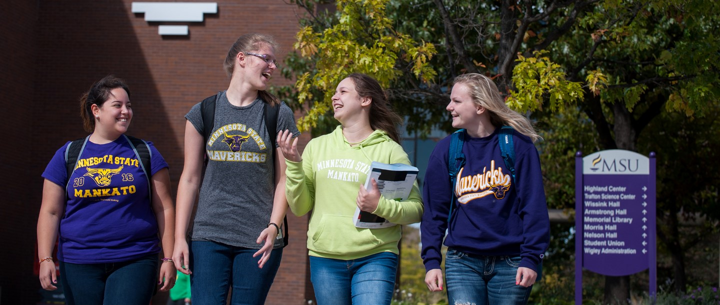 Smiling students walking on campus